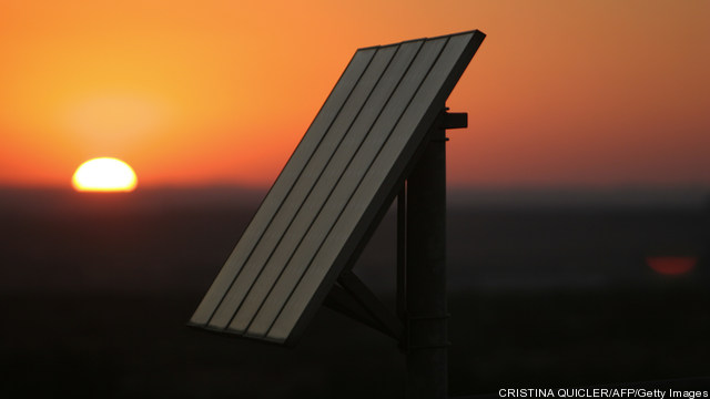 The sun sets on photovoltaic solar panel