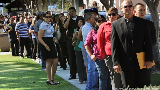 Unemployed Americans line up to enter a