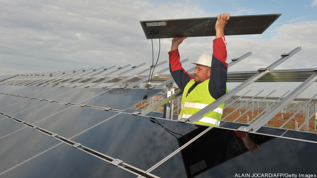 A worker puts on solar panels on Novembe