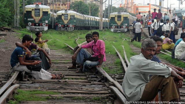 Indian passengers sit on the railway tra