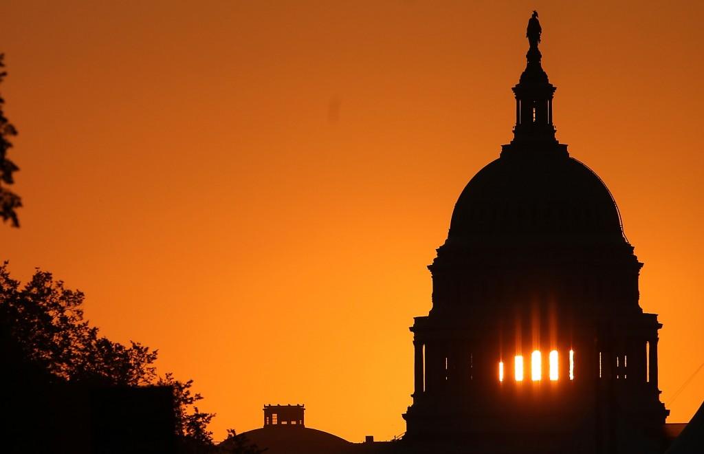 Sun Rises Behind U.S. Capitol Building