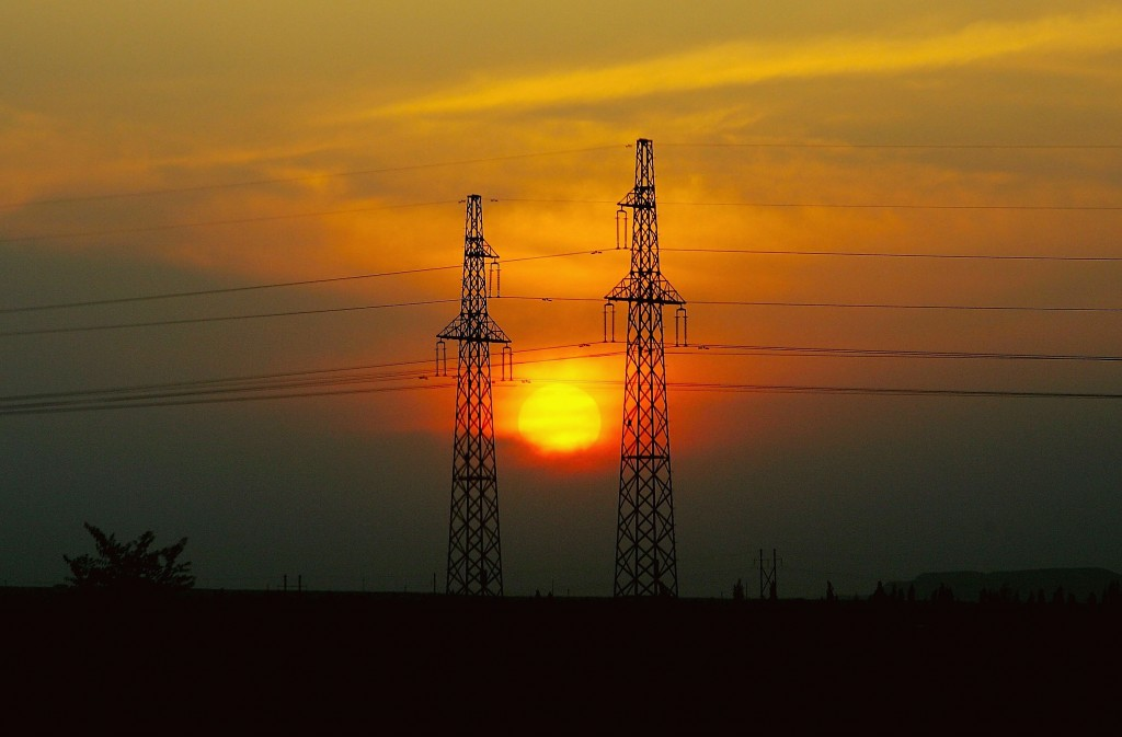 The Sun Sets Down Between Transmit Electricity Towers In Shihezi