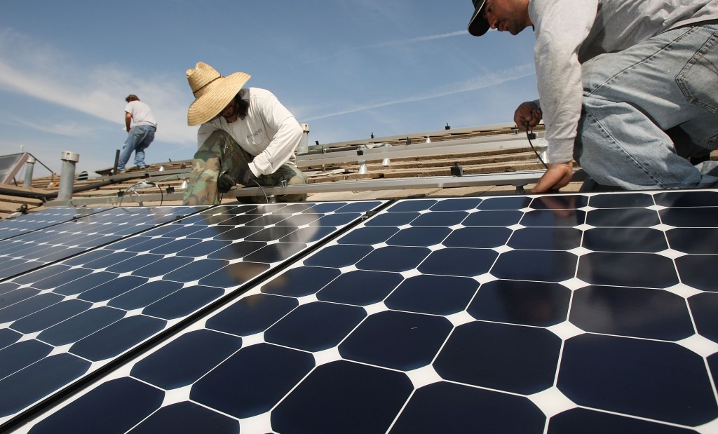 Work Crew Installs Solar Power Panels In Santa Monica