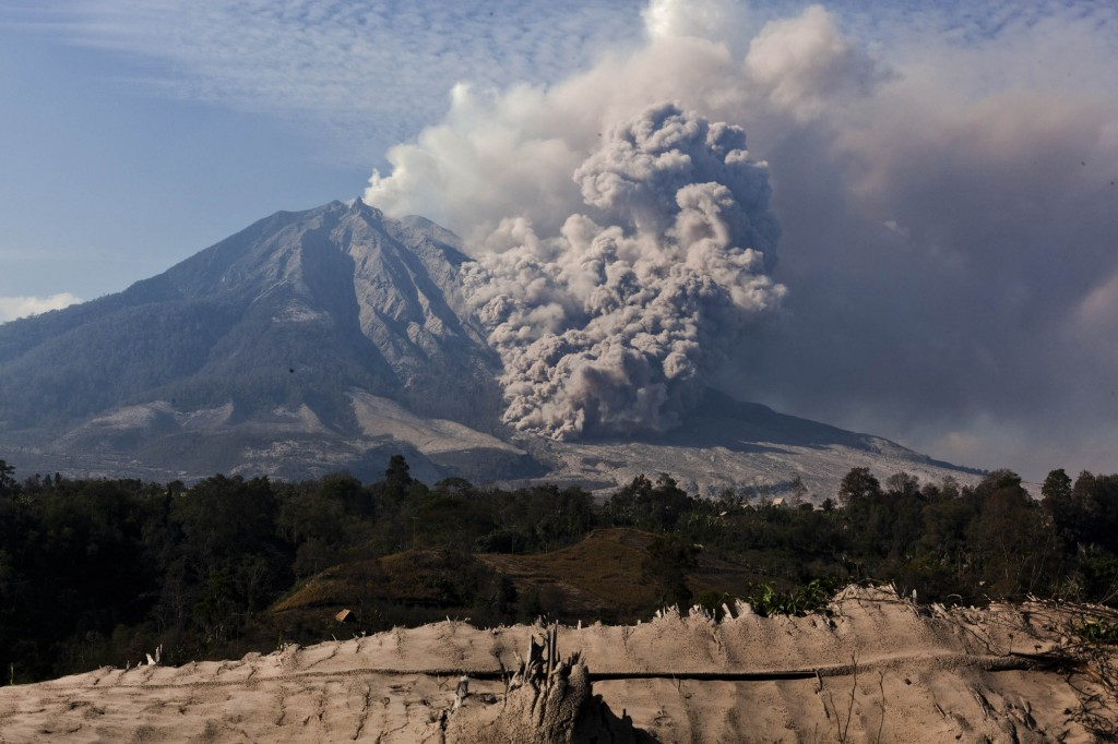 Mount Sinabung Continues To Erupt As People Return To Their Villages