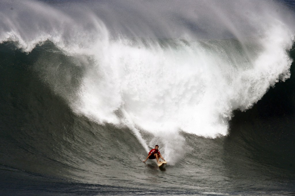 Big Wave Surfers And Onlookers Flock To Oahu's North Shore For Large Swells
