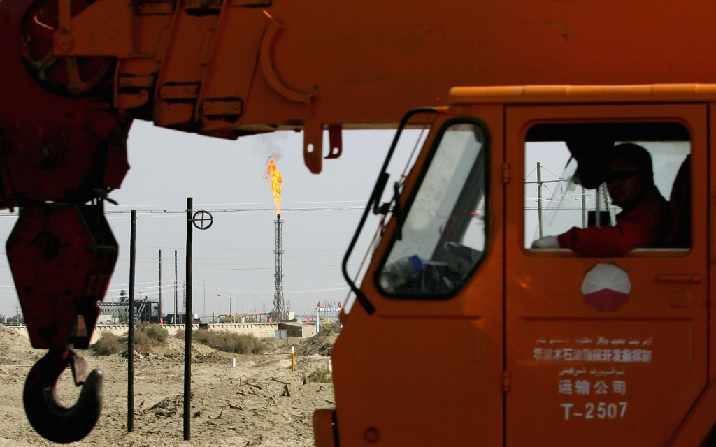 Chinese Labourers Work At Lunnan Oilfield In Xinjiang