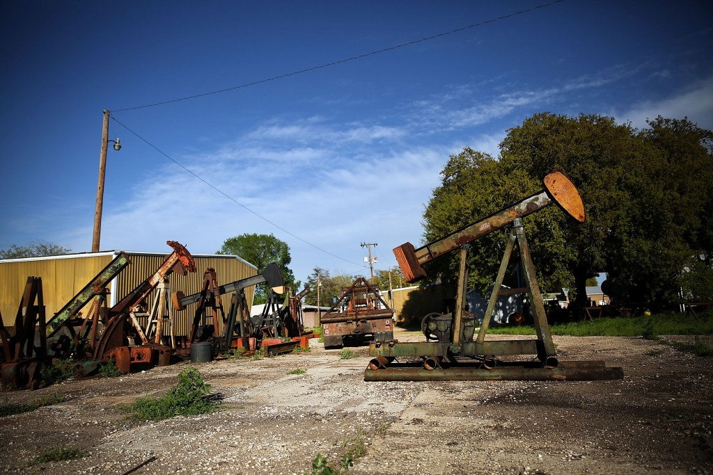 "LULING, TX - MARCH 26: Old ""pump-jacks"" are viewed on March 26, 2015 in the oil town of Luling, Texas. Texas, which in just the last five years has tripled its oil production and delivered hundreds of billions of dollars into the economy, is looking at what could be a sustained downturn in prices. Crude oil prices today are almost 60 percent lower than they were six months ago.While the Texan economy has become more diversified over the years, oil is still the states largest monetary generator and any sustained downturn would be devastating for employment and the economy. Outplacement firm Challenger, Gray & Christmas this month said a drop in oil prices have been responsible for 39,621 job cuts in the first two months of the year.  (Photo by Spencer Platt/Getty Images)"