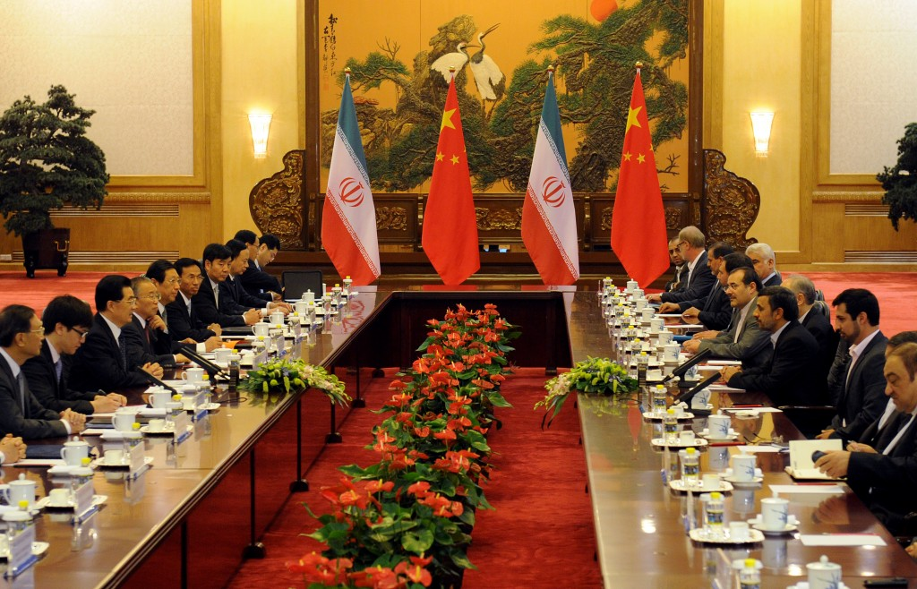 BEIJING, CHINA - JUNE 8:  Chinese President Hu Jintao (Center-L) attends a bilateral meeting with Iran's President Mahmoud Ahmadinejad (Center-R) at the Great Hall of the People on June 8, 2012 in Beijing, China. According to reports, China announced that it will provide a 150 million yuan (23.8 million US dollars) grant to the Afghan government during 2012. (Photo by Mark Ralston - Pool/Getty Images)