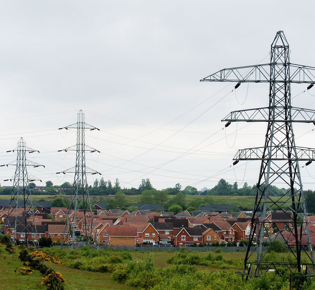 BIRMINGHAM, UNITED KINGDOM- JUNE 3:  Pylons are seen situated over a residential housing area on June 3, 2005 in Birmingham, England. Research released suggests that living too close to overhead powerlines apears to cause a higher risk in childhood leukaemia. The study concluded that children who lived within 200m of high voltage lines were at 70% higher risk. (Photo by Matt Lewis/Getty Images)