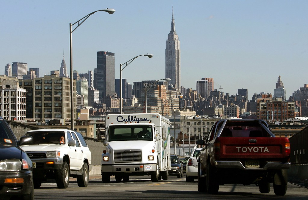 HOBOKEN, NJ - FEBRUARY 23:  Trucks and cars drive with the Manhattan skyline in the background February 23, 2005 in Hoboken, New Jersey. According to the Clean Air Task Force, an average of 2,729 early deaths from diesel engine pollution occur per year in the New York metropolitan area, the highest rate in the nation. According to the report, diesel exhaust causes over 20,000 early deaths nationwide a year.  (Photo by Mario Tama/Getty Images)