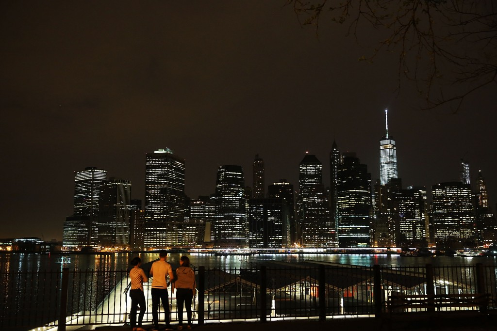 NEW YORK, NY - MAY 05:   The Manhattan skyline is viewed from Brooklyn on May 5, 2015 in New York City. In an effort to reduce Manhattan's carbon footprint, New York's City Council is considering a bill that would limit the amount of external light commercial buildings may use when empty at night. If approved, the bill could alter the use of lights in nearly 40,000 structures and potentially change the iconic nighttime view of Manhattan. The controversial bill has received support from Mayor Bill de Blasio.  (Photo by Spencer Platt/Getty Images)